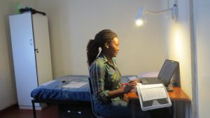 A student reading in her hostel. There is WiFi access in hostels.